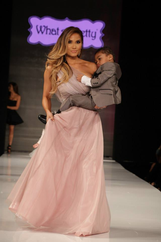 Daphne Joy Carries 50 Cent's Son Sire Down the Runway at Taglyan (Photo By Jeff Linett)