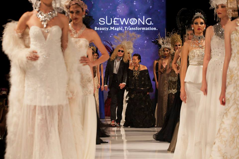 Sue Wong Is Escorted onto the Taglyan Runway After Her Mythos & Goddesses Show (Photo By Jeff Linett)