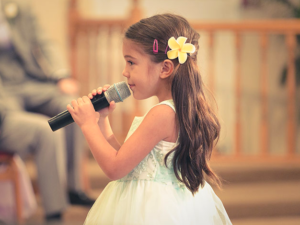 Little Girl Holding Microphone